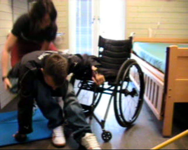 Transfer from wheelchair to floor with assistance