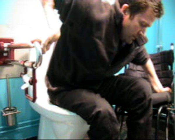 Transfer from toilet to wheelchair