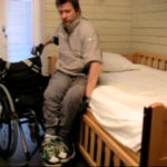 Transfer from wheelchair to bed