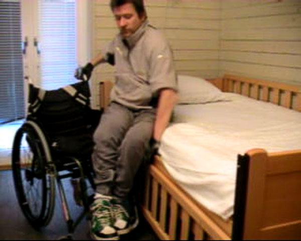 User transfers from wheelchair to bed