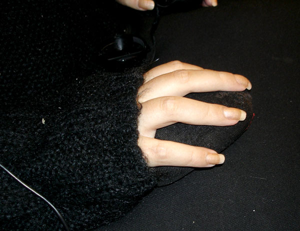 The user with lap cushion and hand cushion (close-up)