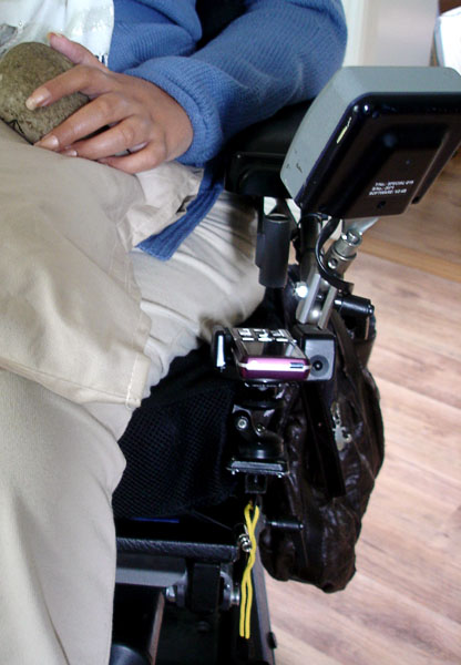 Mobile phone with holder on wheelchair
