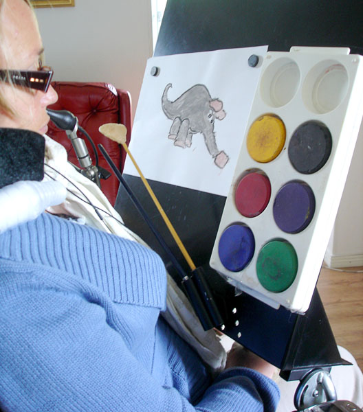 User with easel on wheelchair