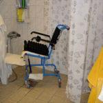Shower chair with holder for ventilator tube