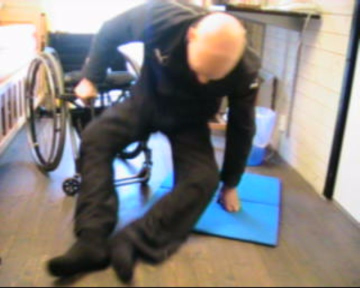 Transfer from floor to wheelchair with straight legs