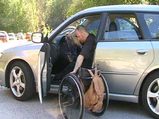 Placing a wheelchair into a passenger car