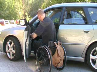 Transfer from wheelchair to driver's seat in car