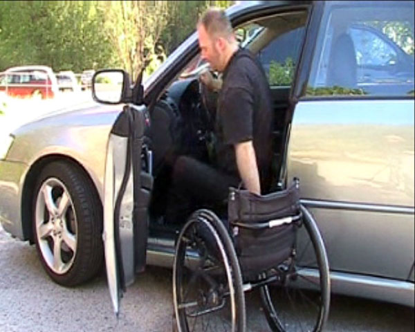 Transfer from driver's seat of car to wheelchair