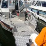 Folding ramp on motorboat
