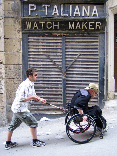"""Push stick"" for wheelchair"