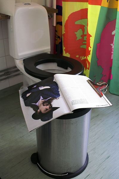 Book lying on wastebasket held open with paper clip