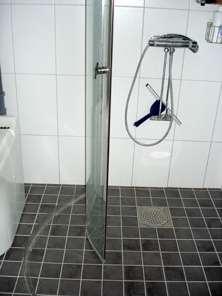 Shower stall with shower wall folded