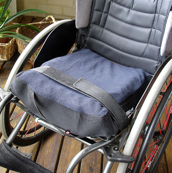 Wheelchair cushion attached with strap