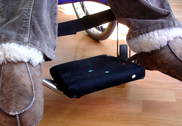 Soft footrest attached to the user's foot bar