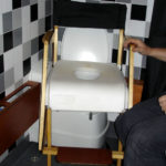 Custom-built shower chair for adapted RV