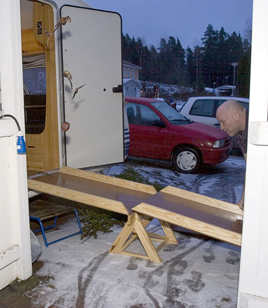 Helena's husband puts together wooden ramp to RV