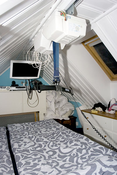 Ceiling lift above loft bed