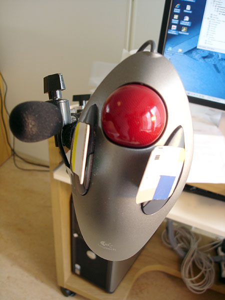 Adapted trackball mouse in holder