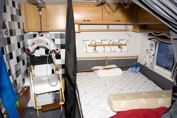 Double bed, toilet, shower and ceiling lift in accessible RV