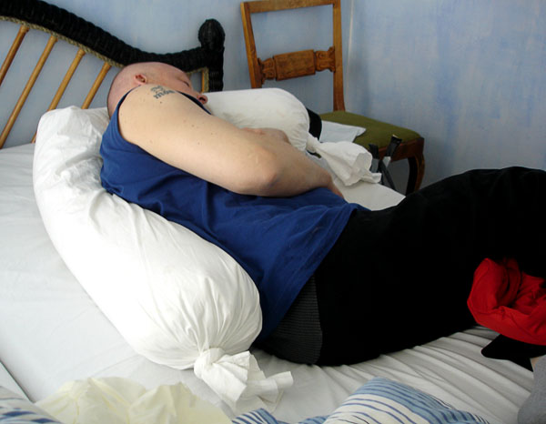 User lying on side in bed with kinesthetic roll