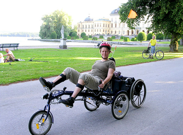 Recumbent bicycle with electric wheel and tow hook for wheelchair
