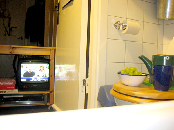 TV on trolley outside bathroom door