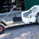 Go-cart with electric motor to trim flower beds
