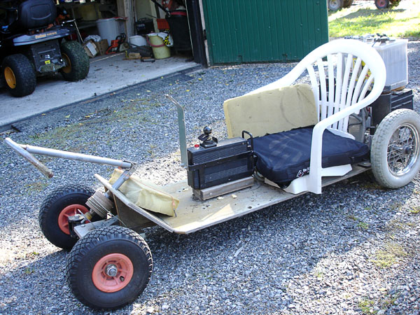 Go-cart with electric motor, steering lever folded up