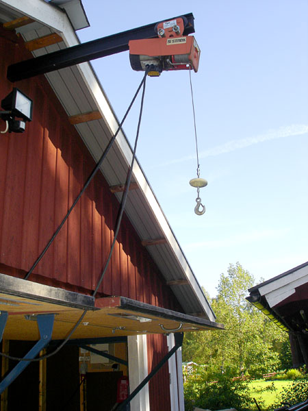 Electric winch attached under roof ridge