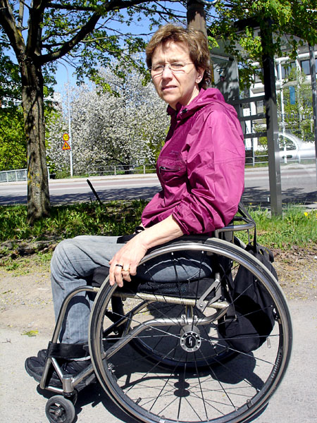 The user with her individually adapted wheelchair