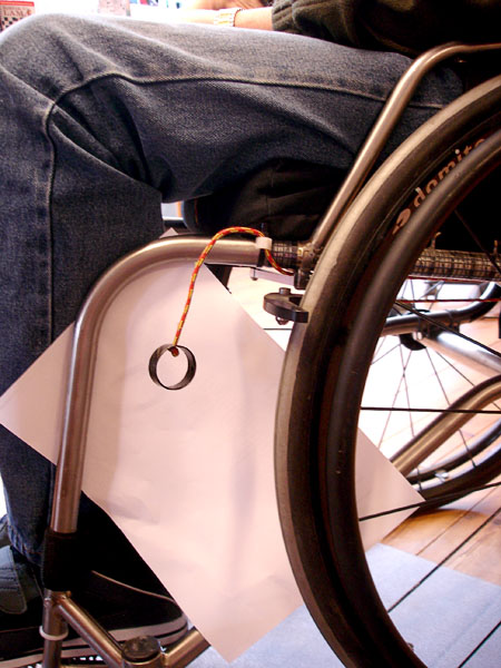 Adapted wheelchair brake
