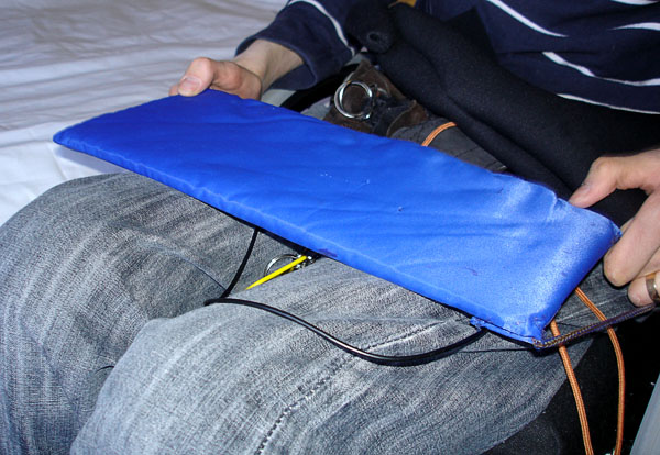 User with sliding board in fabric bag (top visible)