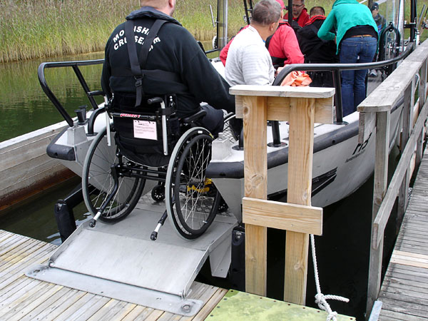 Folding bow ramp in accessible boat