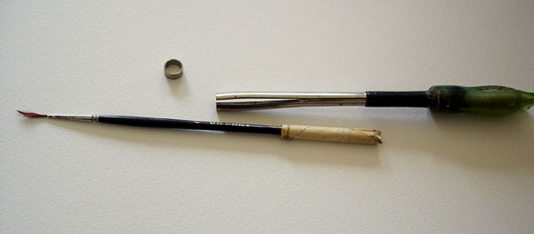 Pen extension, screw mount, and brush next to it