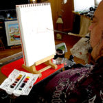 Paint with watercolors by mouth