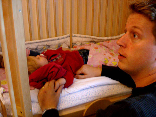 User takes care of daughter in crib; gates are open