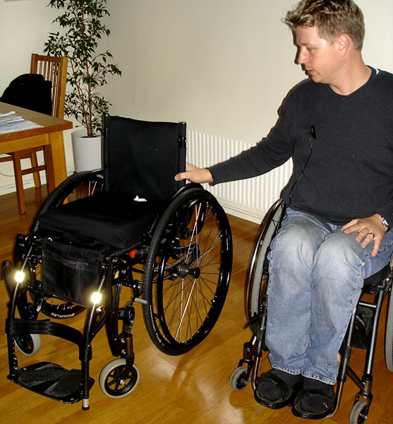 User in standing wheelchair