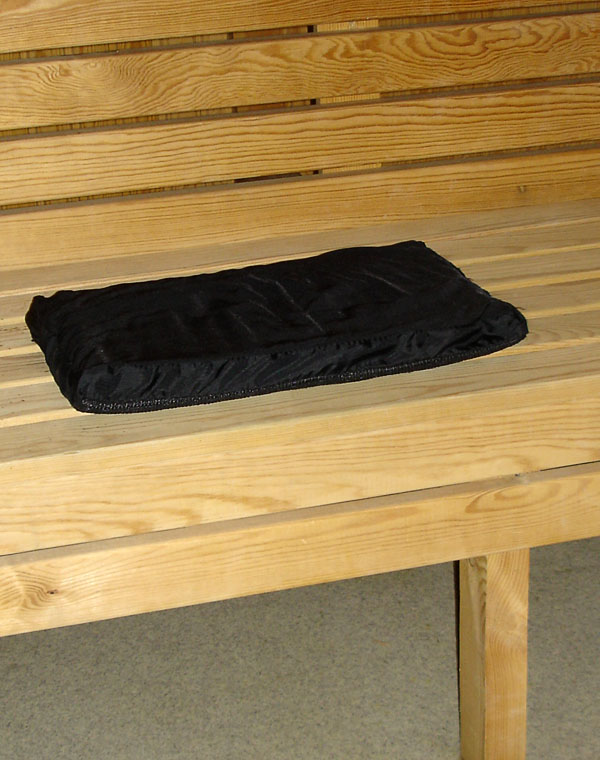 Pressure-relieving cushion on sauna bench