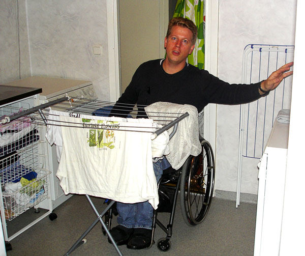 User hangs laundry in laundry room