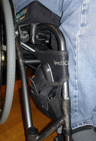 User's wheelchair with customized belt attached to the side