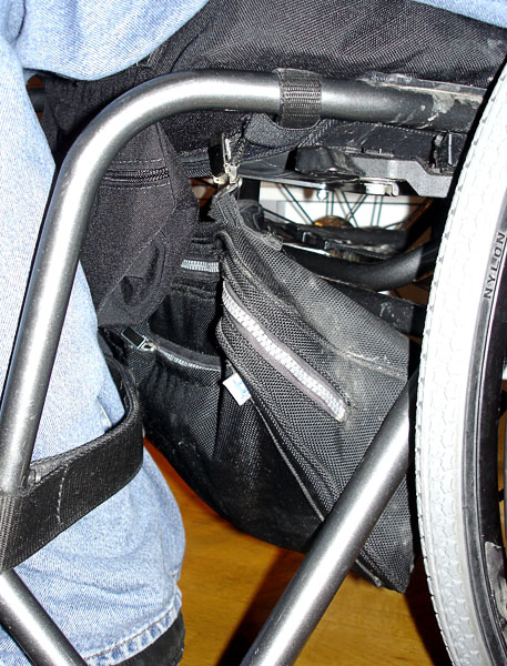User's wheelchair with case attached under he seat