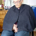 Cape with detachable lining
