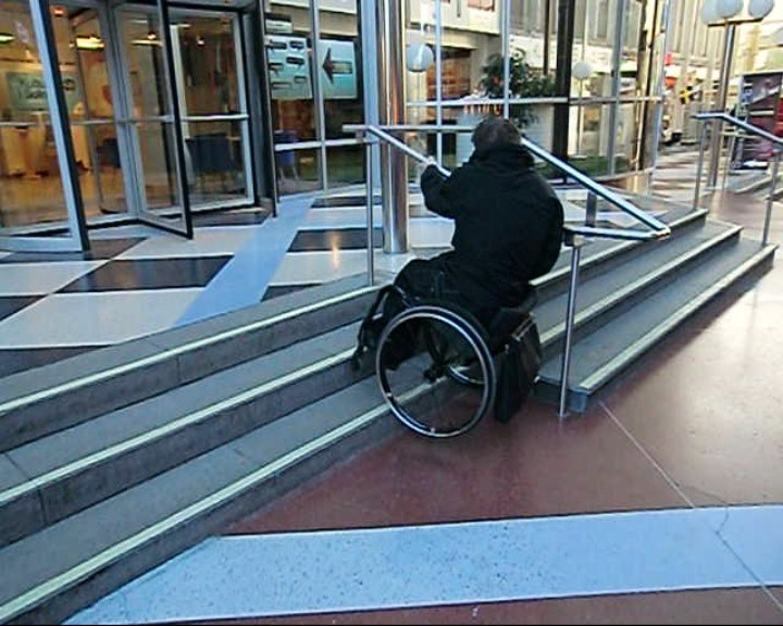 Going up stairs with handrail in a wheelchair