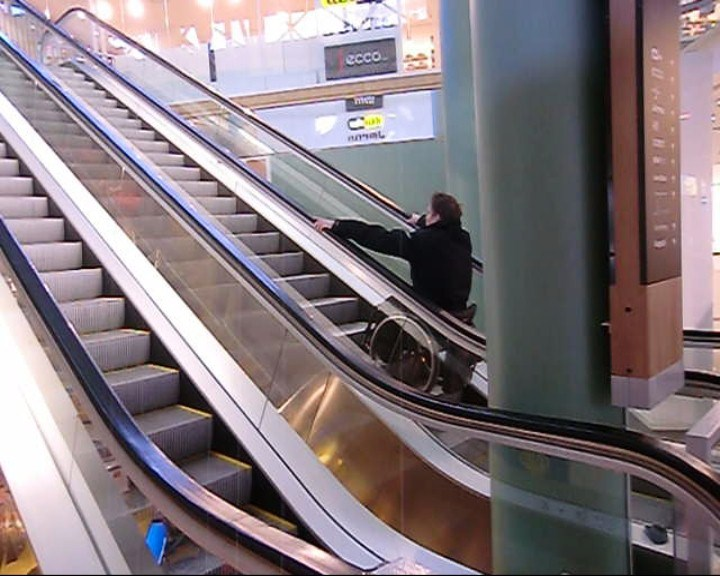 Ride up an escalator in a wheelchair
