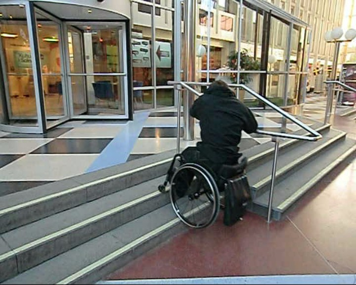 Go down a flight of stairs with handrail in a wheelchair