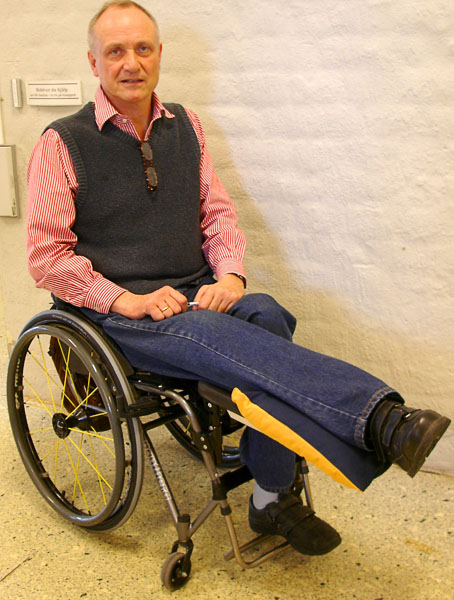 Legs in raised position in active wheelchair