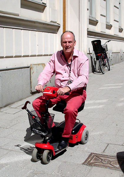 User drives his scooter outdoors