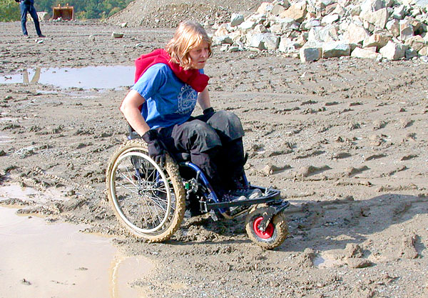 User with off-road chair on a sandy beach