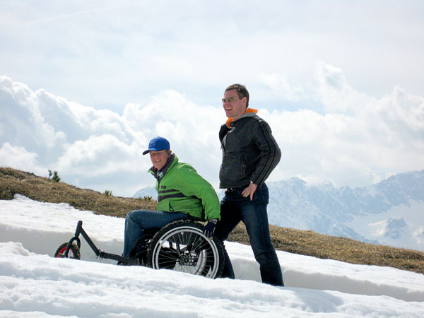 User with off-road chair in snow on the mountains