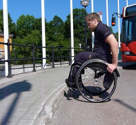 Go up a curb in a wheelchair